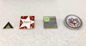 PHFE Heluna commemorative pins